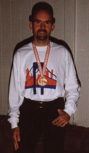 Ray proudly displays his medal and t-shirt