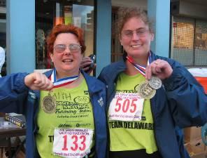 Faith and Celine display medals