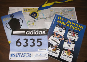 Race bib, medal, course map